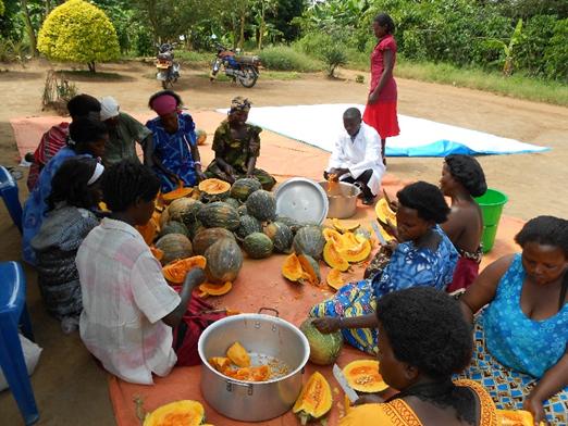 Women preparing the pumpkins.  Photo: Supplied.