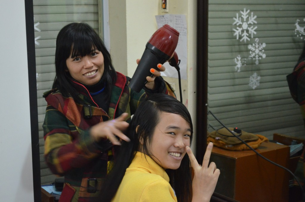 A REACH student learns hairdressing skills. Photo: Supplied.