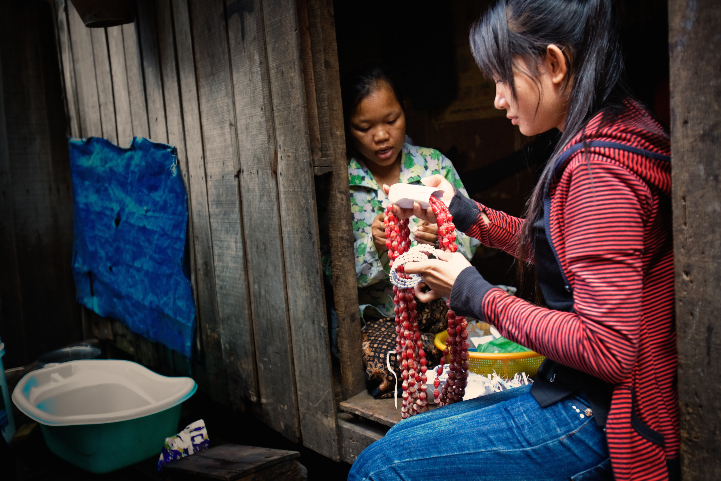 Riverkids teaches women skills such as jewellery-making, which they can do at home. Photo: Supplied.